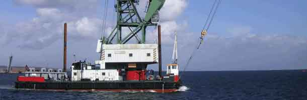 Crane on its way to capsized floating jetty